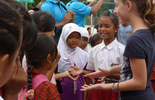 We taught the local students some hand-clapping games.