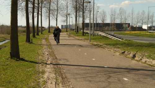 A sight I won't see so often in future...Mevrouw T cycling behind me.