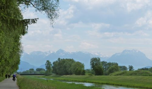 Water, greenery, snow, alps and sun.