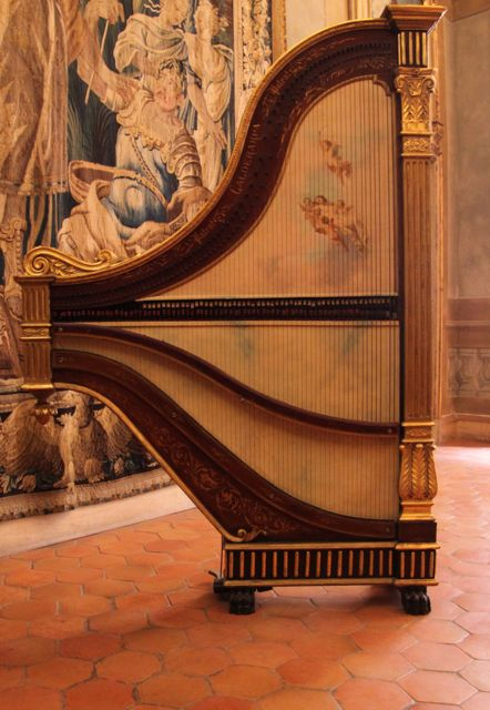 It's a piano on one side, a harp on the other. Made by Luigi Caldera, Turin, 1889.