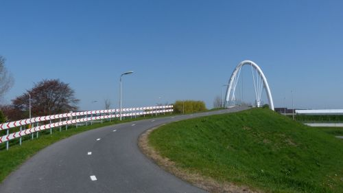 Only in the Netherlands. An elaborate bridge over a major road, just for cyclists.