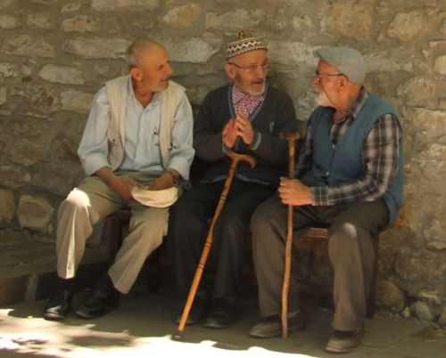 I think they run a roster system, the village retirees paid to sit in groups of three and pose for tourists.