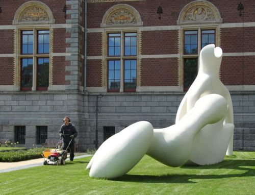 They're mowing the lawn to keep the sculpture looking neat.