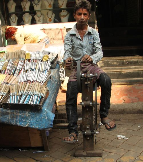 Sharpening knives by pedal power.