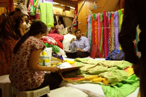 Wholesale fabric salesmen at Malgadas Market.