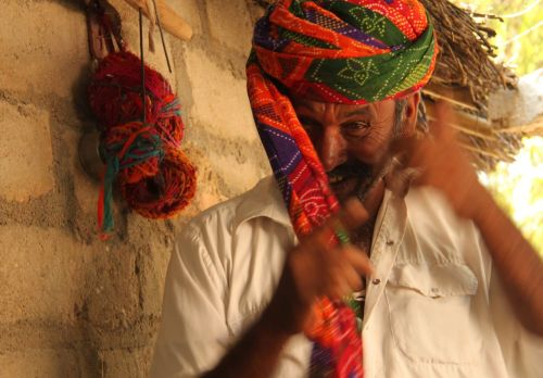 A demonstration of turban tying. The hand is faster than the shutter.