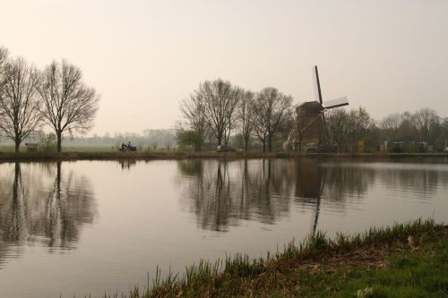 By the Amstel River. 'Amster-dam' = 'Dam on the Amstel', remember?