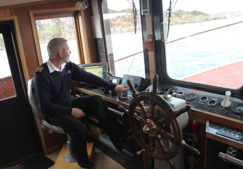 Anyone is welcome to join skipper Sandy on the bridge.