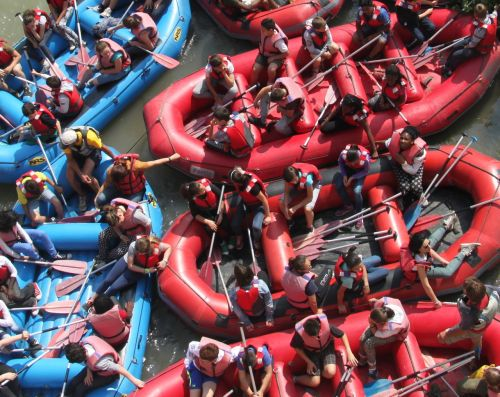 Packed to the rafters, ready to ride the rapids on the River Adige.