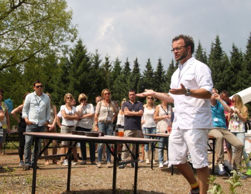 Celebrity baker Edwin Klaasen directs his team to prepare bread for the portable oven.