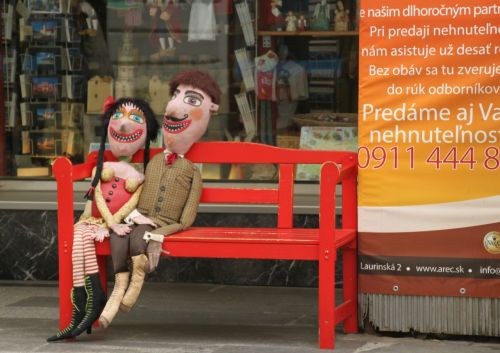 Not exactly public art, but it seems to be compulsory for Slovakian souvenir shops to place these people on a bench by the door.