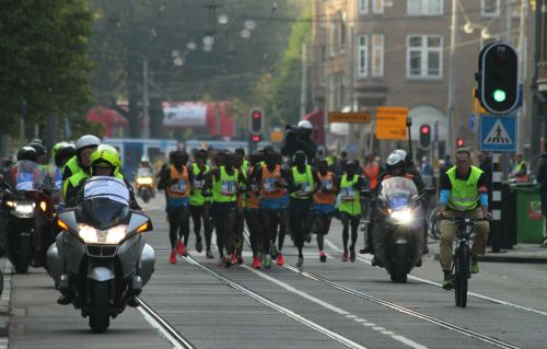The start was only four minutes ago and already they're a couple of kilometres down the Amstelveenseweg.