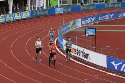 Into the final lap in Amsterdam's Olympic Stadium.
