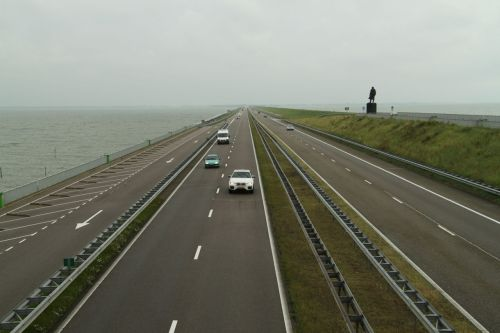 The dyke that turned the Zuiderzee into the IJsselmeer. The statue is of Mr Cornelis Lely, the engineer of the project to reclaim the area that is now the province Flevoland.