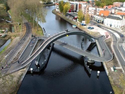 Melkweg ('Milky Way') Bike and pedestrian bridge, Purmerend. Architects: Next. Photo: Velo City, published Prestel 2014.