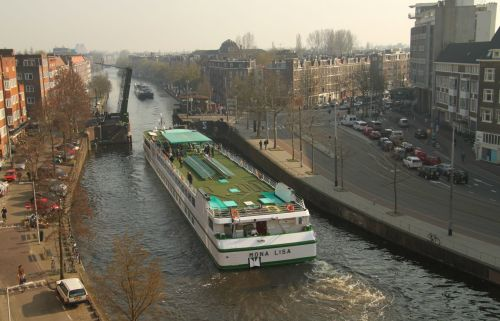 There's always something going on. Somehow this river cruise monster made it through a seemingly impossible gap.