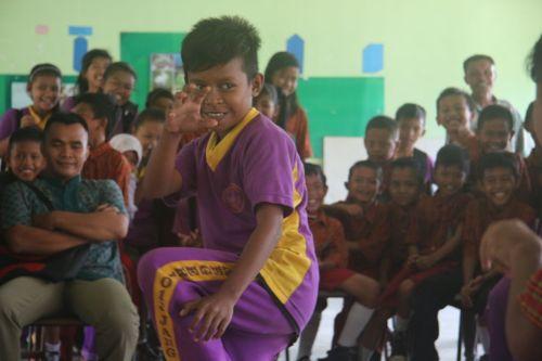 Boys display their martial arts skills.