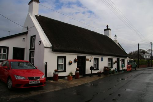 Our starting point - Fool's Haven, Carrickfergus. Note our very fast red rental car, ready for the journey.