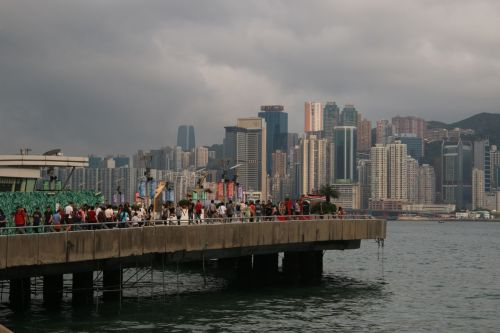...to join the crowds again, doing what everyone says is good about Kowloon, looking across the Harbour to Hong Kong.
