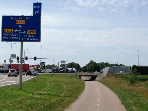 Near Schiphol Airport, there's a busy intersection. But look - the cycle path goes underneath it.