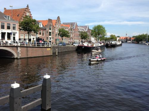I pause on the (bikes and pedestrians only) bridge over the Spaarne River to take the photo...