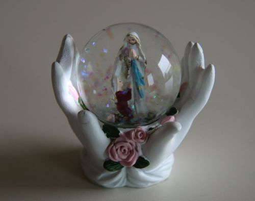 Finest quality souvenir: St Bernadette and the beautiful lady, made in China.